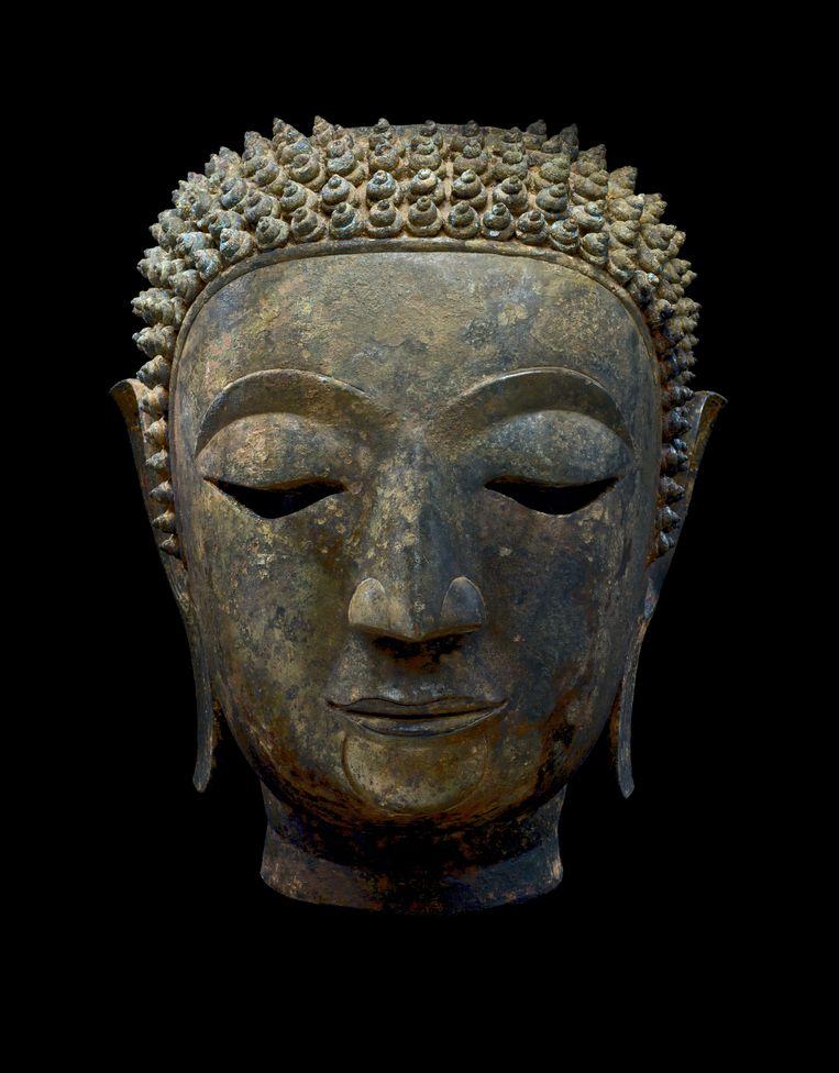 Hoofd van Boeddha Śākyamuni, Thailand, koninkrijk Lan Na, Chieng Sen, 15de eeuw. Ger Eenens Collection, The Netherlands/Wereldmuseum Rotterdam.   Beeld Erik en Petra Hesmerg