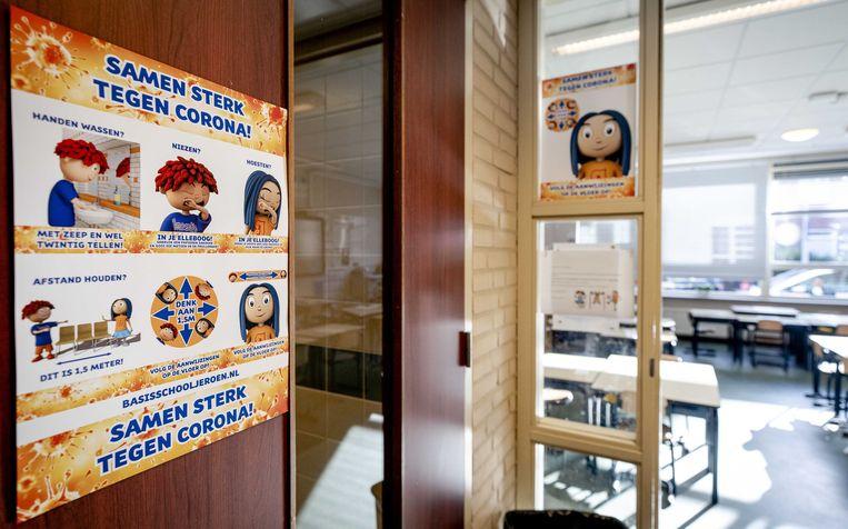 Aanwijzingen van een school in Den Haag om verspreiding van het coronavirus tegen te gaan. Beeld ANP