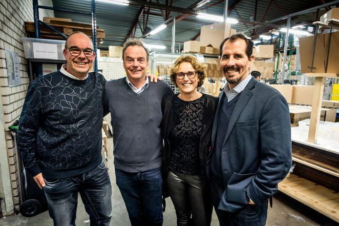 Samenwerkende partijen in het magazijn van MamaLoes in Goirle: vlnr mede-eigenaar Marco Kluwen, Jos Verhoeven (Start Foundation), mede-eigenaar Loes de Volder, Mike Brady (Greyston).