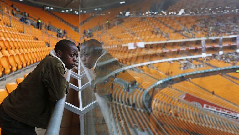 De 14-jarige Thomas in het Soccer City-stadion in Johannesburg. Beeld ap