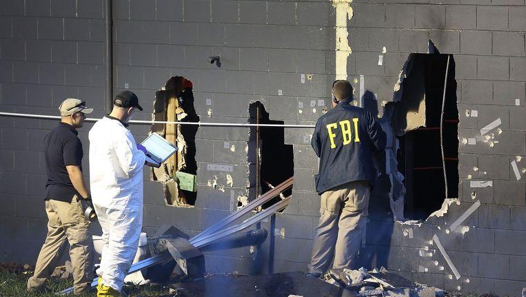 FBI-onderzoek bij de beschadigde muren van homoclub Pulse Beeld afp