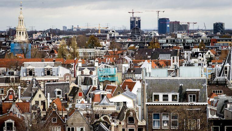 De Amsterdamse huizen zijn voor veel jonge gezinnen met kinderen te duur. Ze vertrekken naar omliggende gemeenten. Beeld anp
