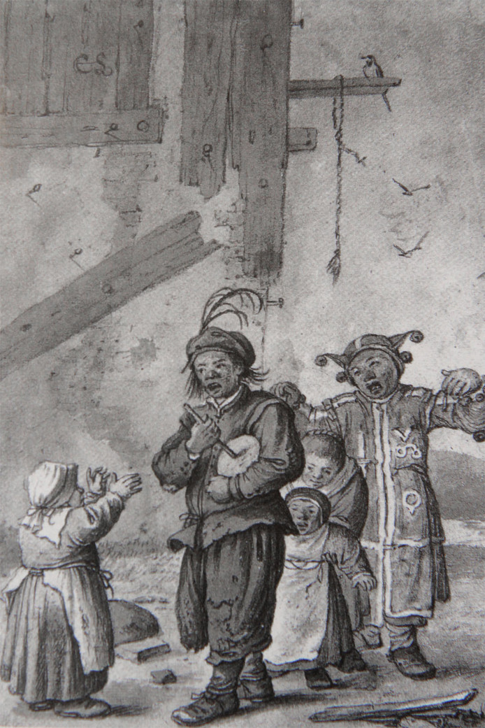 Kinderen in optocht met rommelpot langs de deur.