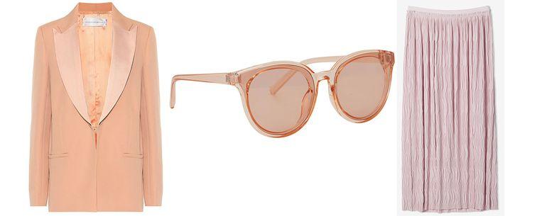 Satijn-wollen jasje van Victoria Beckham via My Theresa € 705 Abrikoosroze zonnebril van Nümph € 14,95 Roze rok van Filippa K € 255 Beeld