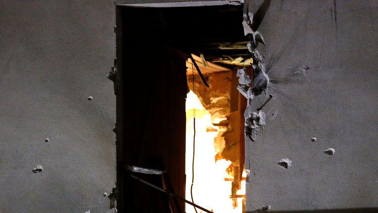 Het gehavende pand in de Parijse voorstad Saint-Denis. Beeld AP