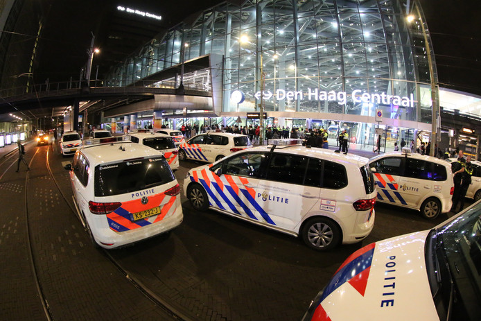 The police flocked out to keep people outside The Hague Central station.