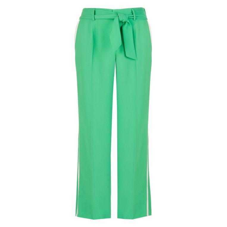 Pantalon van Xandres Xline, €149, www.xandres.com.