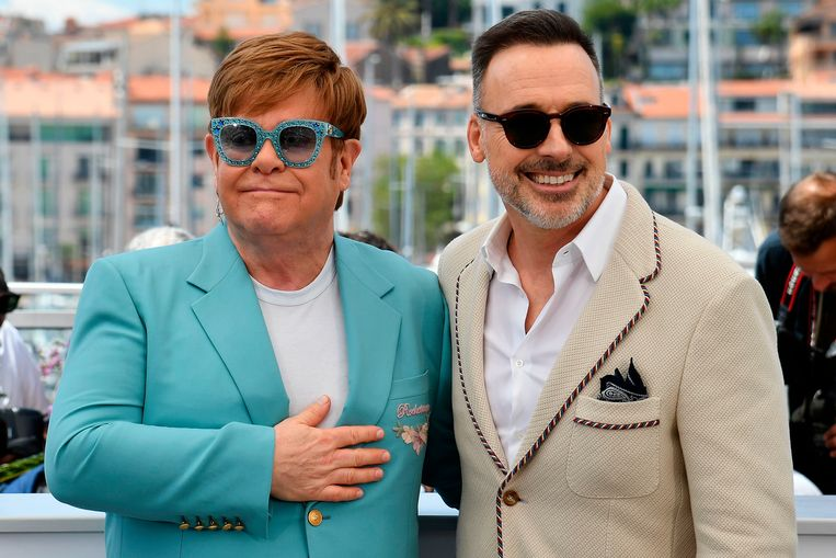 Elton en zijn partner.