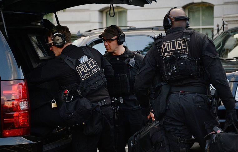 Leden van het presidentiële beveiligingsteam komen aan bij het Witte Huis. Beeld White House Photo