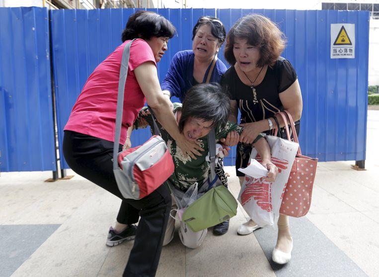 Bao Lanfang verloor haar zoon, schoondochter en kleinkind (3) bij het vliegtuigincident. 236 anderen kwamen ook om het leven.