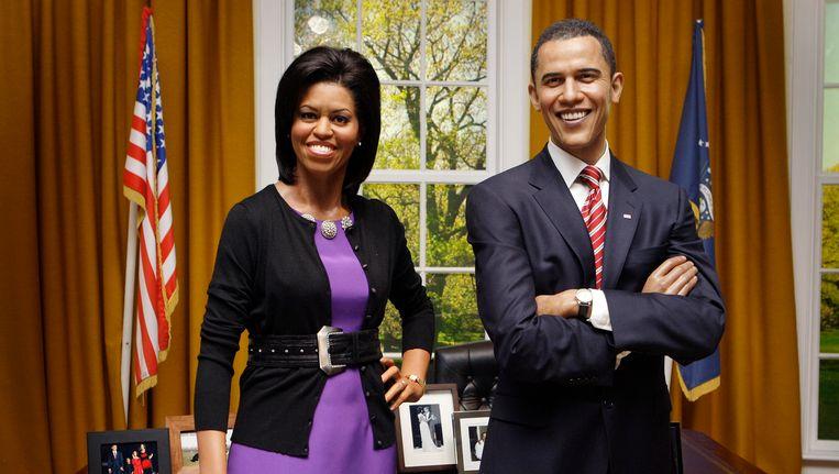 De Amerikaanse president Barack Obama en zijn vrouw Michelle Obama in Madame Tussauds in Londen. Beeld AP