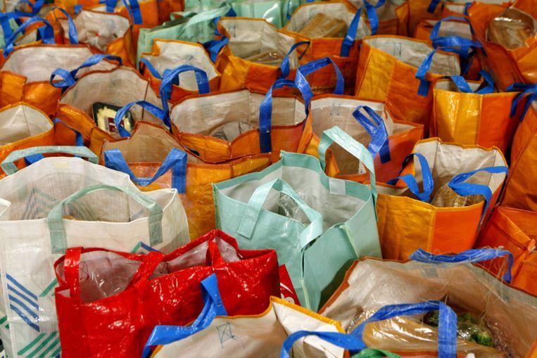 De Voedselbank schenkt de voedselpakketten aan mensen die beneden het bestaansminimum leven. Foto ANP/Koen Suyk Beeld