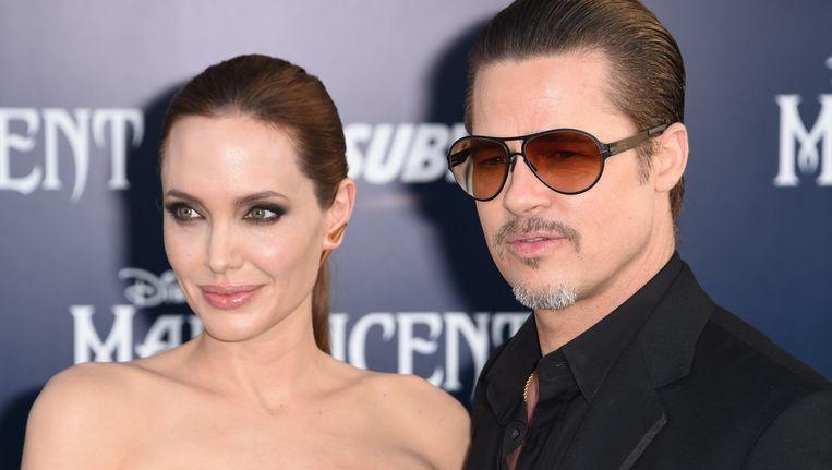 Angelina Jolie en Brad Pitt op de première van Jolies film Maleficent in mei. Beeld afp