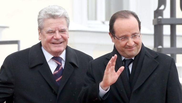 De Duitse president Joachim Gauck samen met ambtgenoot François Hollande Beeld epa
