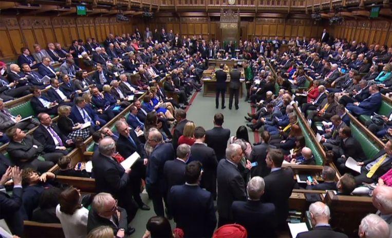 Een afgeladen Lagerhuis, donderdag bij de derde stemming over de Brexit. Beeld AFP