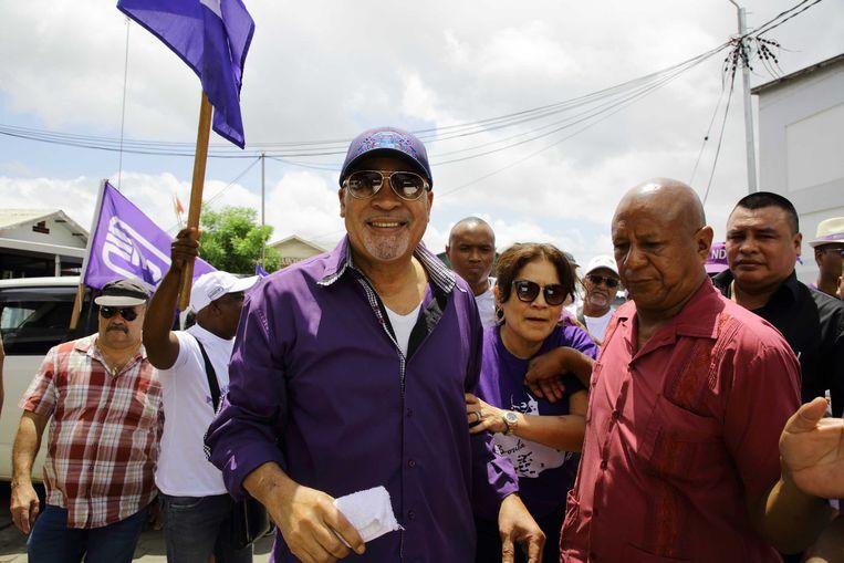 Desi Bouterse tijdens een verkiezingscampagne in de vorm van een optocht van de Nationale Democratische Partij (NDP).  Beeld ANP