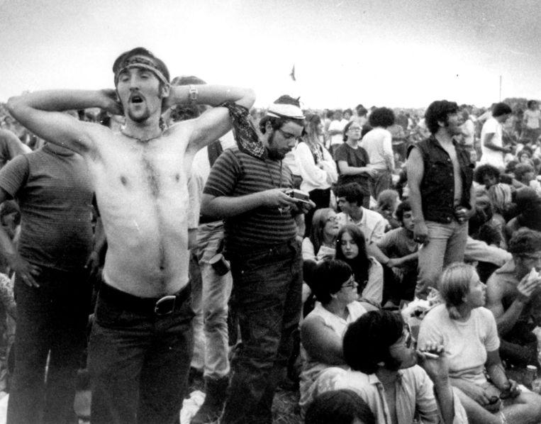 1969, muziekfans bij het legendarische popfestival Woodstock in Bethel, NY. Beeld AP