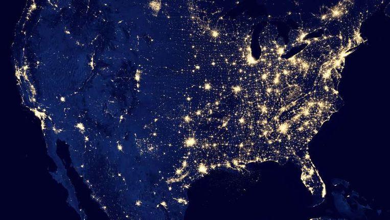 De Verenigde Staten bij nacht, op een foto van Nasa. Thorium zou in potentie de hele wereld tienduizenden jaren van elektriciteit kunnen voorzien. Beeld AFP