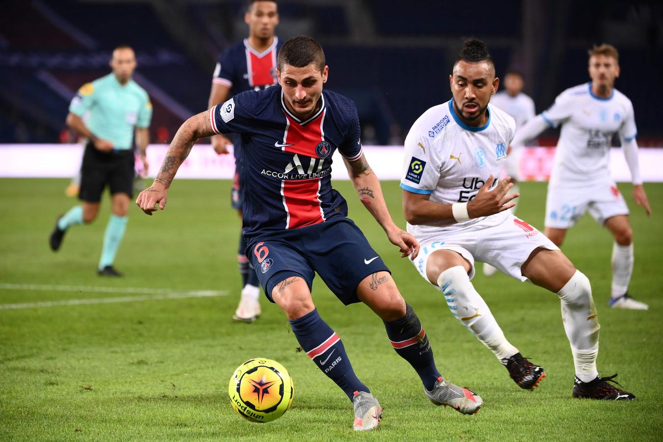 Marco Verratti (l) namens PSG in duel met Dimitri Payet van Olympique Marseille.