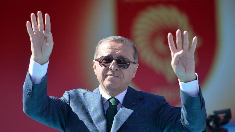 Recep Tayyip Erdogan tijdens een bijeenkomst op 2 april in Ankara. Beeld afp