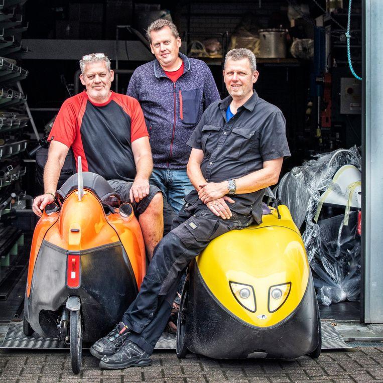 De drie broers van Flevobikes: van links af Erwin , André en Arjan Vrielink.  Beeld Raymond Rutting / de Volkskrant