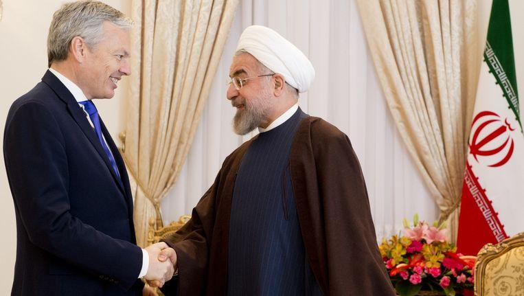 Didier Reynders met de Iraanse president Hassan Rohani. (Archiefbeeld)
