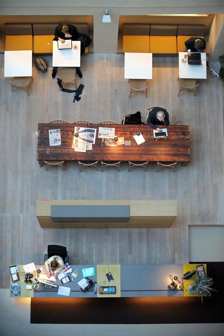 Een werkruimte voor zzp'ers aan de Herengracht in Amsterdam. Beeld Joost van den Broek