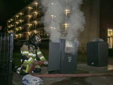Ondergrondse papiercontainer in brand gezet in Tiel