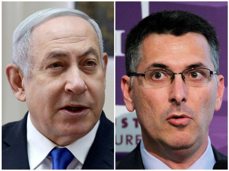 De Israëlische premier Benjamin Netanyahu (links) en zijn uitdager en partijgenoot Gideon Sa'ar. Beeld REUTERS