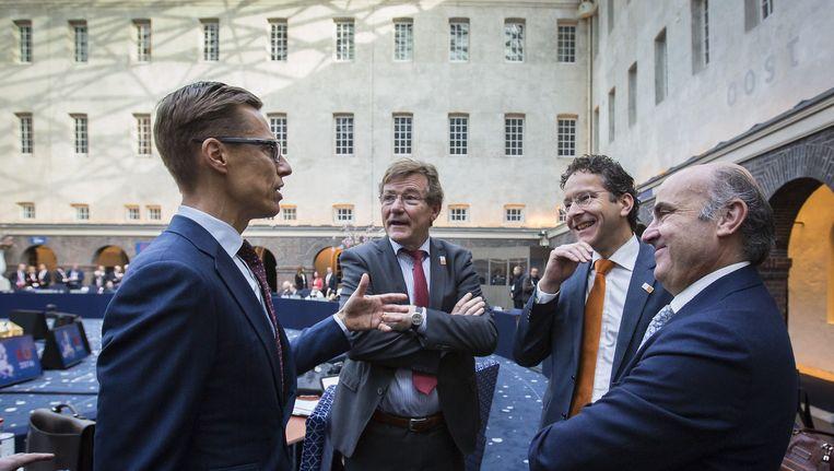 Minister van Financiën Dijsselbloem te midden van zijn Finse, Belgische en Spaanse collegas in het Scheepvaartmuseum in Amsterdam. Beeld anp