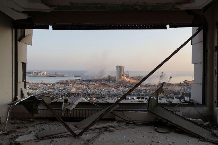 Door de explosie is een groot deel van de haven verwoest.  Beeld AP