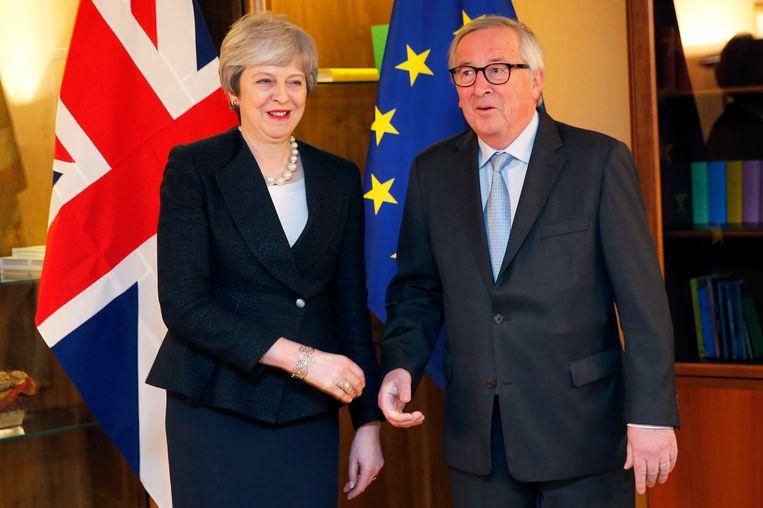 De Britse premier Theresa May en Jean-Claude Juncker, de voorzitter van de Europese Commissie.