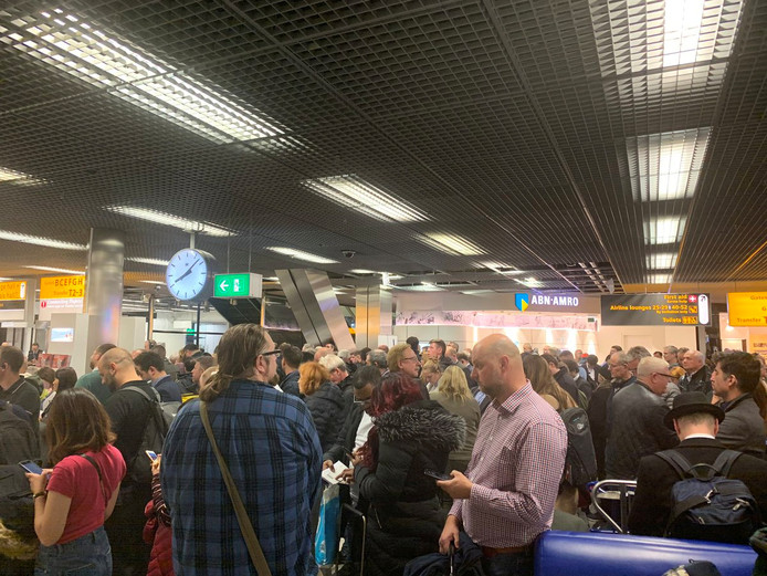 Passengers stand inside Amsterdam's Schiphol Airport during a security alert, Netherlands November 6, 2019 in this picture obtained from social media. Mark Crompton/via REUTERS   ATTENTION EDITORS - THIS IMAGE HAS BEEN SUPPLIED BY A THIRD PARTY. MANDATORY CREDIT. NO RESALES. NO ARCHIVES.