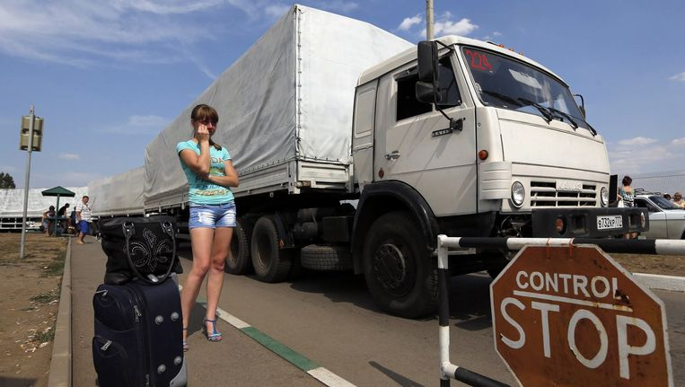 Het konvooi telt zo'n 270 witgeschilderde Russische legertrucks. Beeld reuters