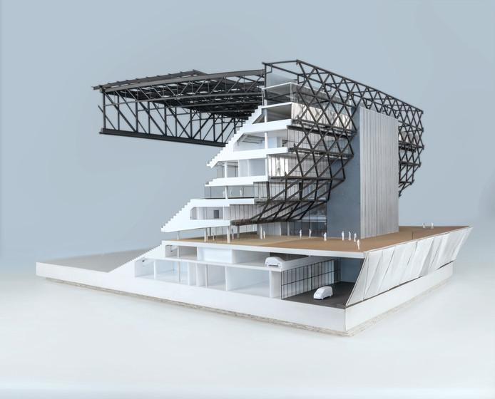 Maquette van een deel van het nieuwe stadion aan de Maaszijde. Opvallend is de donkergrijze staalconstructie die gedragen wordt door de betonnen kernen met trappenhuizen en liften.