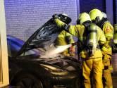Tesla in brand aan De Boekweit in Heesch