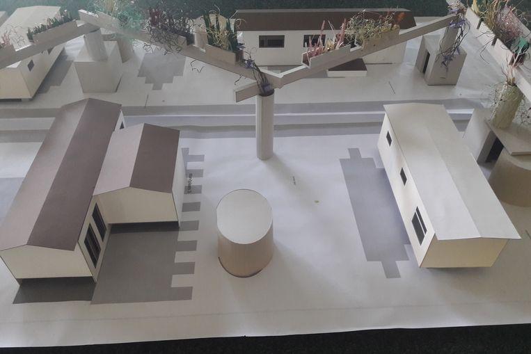 Een maquette van hoe het woonwagenpark er zal uitzien. Centraal is een opvallende plantenpergola.