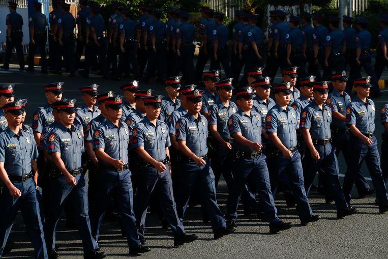 Leden van de Filipijnse nationale politie in Manila. Beeld null