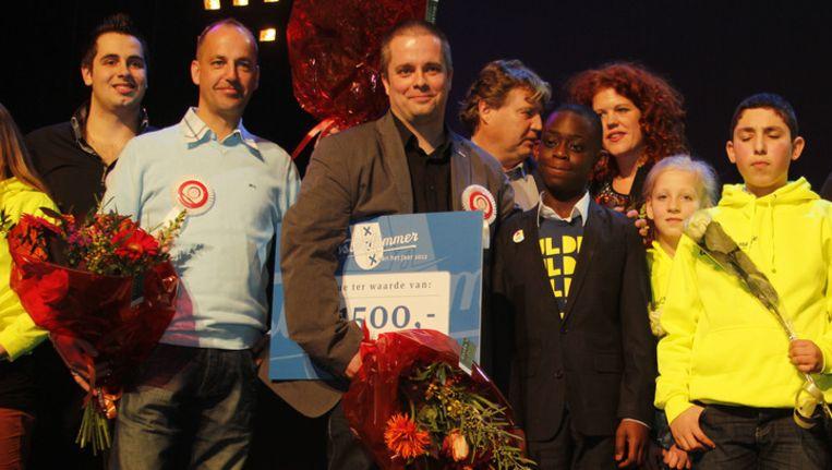 Mark van Zandwijk, in het midden van de foto, werd verkozen tot Amsterdammer van het Jaar 2012. Beeld Pieter Dammen