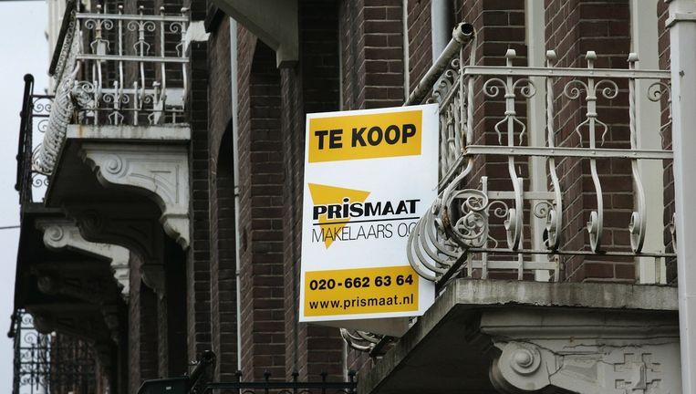 Ook Amsterdam zal de gevolgen van de opheffing van het Zwitsers bankgeheim merken. Beeld anp