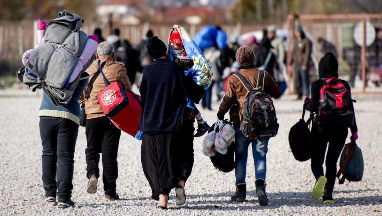 Vluchtelingen in het grensgebied tussen Macedonië en Griekenland. Beeld anp