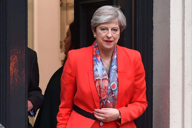May verlaat het hoofdkwartier van haar partij n Londen. Beeld afp