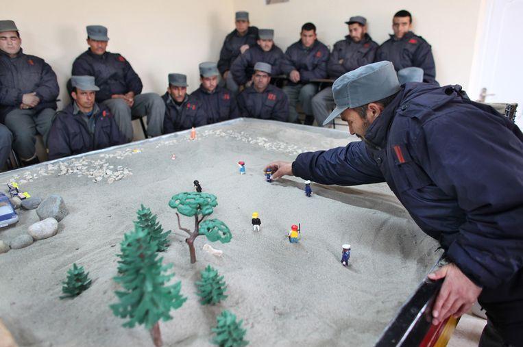 Afghaanse rekruten van de politieschool in Kunduz in 2011. Beeld Ton Koene