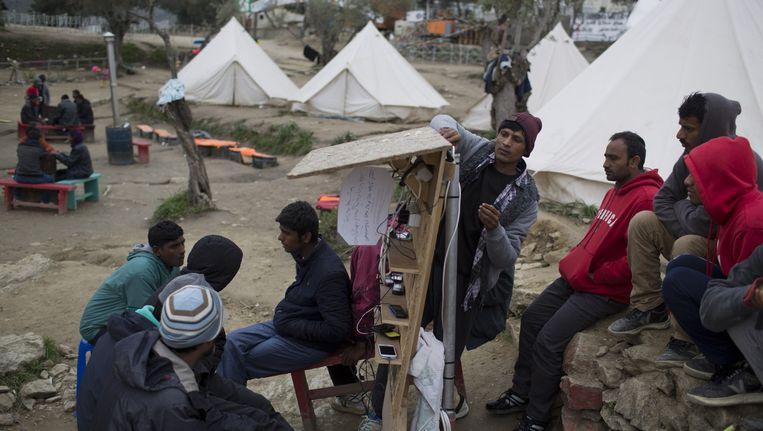 Vluchtelingen in een kamp bij Moria, Lesbos. Beeld ap