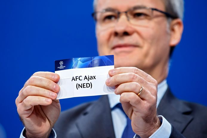 UEFA deputy secretary general Giorgio Marchetti shows a ticket of the dutch soccer club AFC Ajax at the UEFA headquarters in Nyon, Switzerland, Monday, July 22, 2019 during the drawing of the matches for the Champions League 2019/20 third qualifying round. (Salvatore Di Nolfi/Keystone via AP)