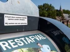 Avri: minder vuilniszakken naast containers