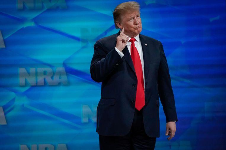 President Trump tijdens een toespraak voor leden van de NRA in april. Veel van zijn kiezers zijn NRA-leden. De organisatie steunde ook zijn verkiezingscampagne in 2016. Beeld REUTERS