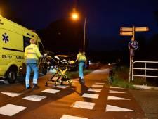 Jonge vrouw op fiets geschept door auto in Den Ham