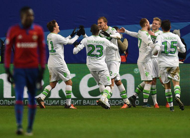 Spelers van Wolfsburg vieren een doelpunt. Beeld getty