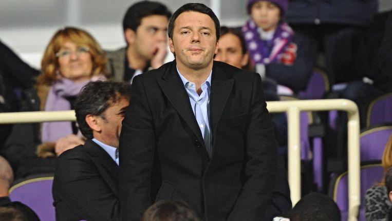 Matteo Renzi rijdens een voetbalwedstrijd in Florence vandaag. Beeld epa